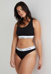 Calvin Klein Underwear - MODERN PLUS THONG - Thong - black - 1