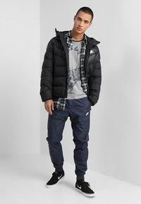 Nike Sportswear - Down jacket - black/white - 1