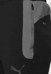 Puma - BVB BORUSSIA DORTMUND EVOSTRIPE PANTS - Tracksuit bottoms - black/castlerock - 4