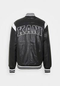 Karl Kani - JACKET UNISEX - Faux leather jacket - black - 1