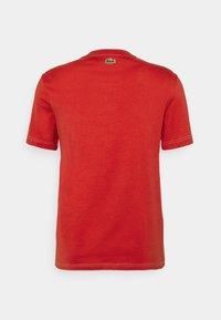 Lacoste - Print T-shirt - cinabre - 8
