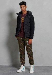 Superdry - SONIC CITY HYBRID - Zip-up hoodie - black - 0