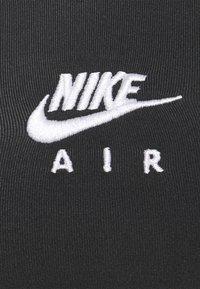 Nike Performance - INDY STRAPPY BRA - Light support sports bra - black/white - 6