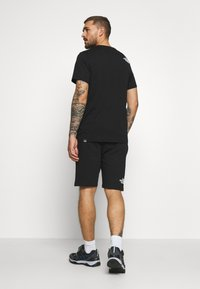 The North Face - RAINBOW SHORT - Sports shorts - black - 2