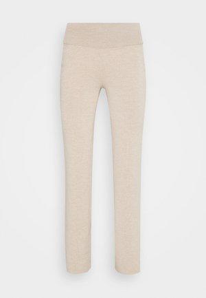 AURA - Leggings - Trousers - sand