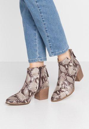NEVA - Korte laarzen - beige
