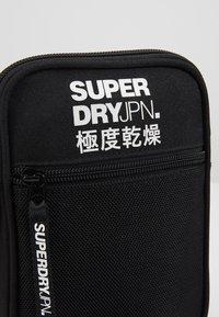 Superdry - SPORT POUCH - Across body bag - black - 2