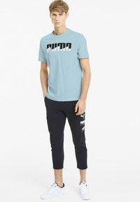 Puma - REBEL BOLD  - T-shirt imprimé - aquamarine - 1