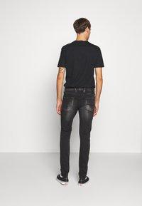 Replay - ANBASS HYPERFLEX BIO - Slim fit jeans - black - 2