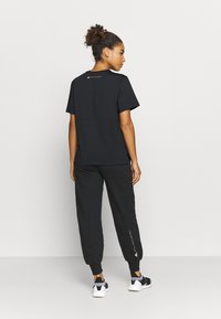 adidas by Stella McCartney - Tracksuit bottoms - black