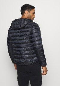 Champion - LEGACY  - Zimní bunda - black - 2
