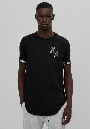 MUSCLE  - T-shirt con stampa - black