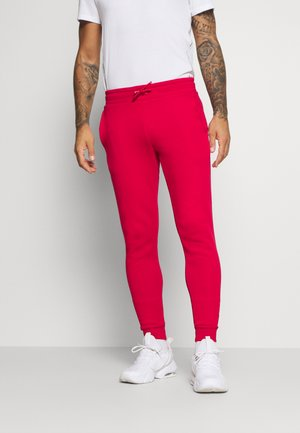 CUFFED FLAG LOGO - Tracksuit bottoms - primary red
