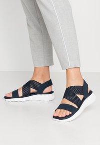 Skechers - ULTRA FLEX - Wedge sandals - navy - 0