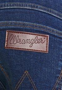 Wrangler - LARSTON - Jeans slim fit - indigo rules - 5