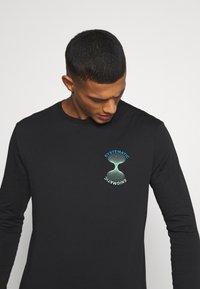 YOURTURN - Long sleeved top - black - 4