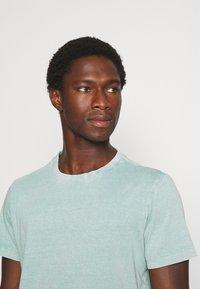 s.Oliver - T-shirt basic - light green melange - 3