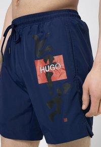 HUGO - Swimming shorts - blue - 2