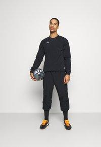 Nike Performance - MIDLAYER CREW - Sports jacket - black/silver - 1