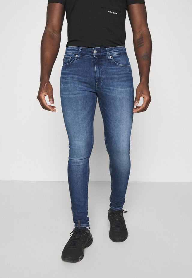SUPER SKINNY - Jeans slim fit - denim dark