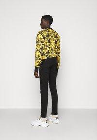 Versace Jeans Couture - AMETIST  - Slim fit jeans - black - 2