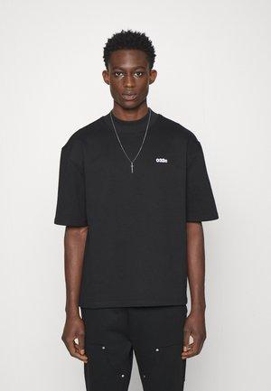 HEAVY UNISEX - Basic T-shirt - black