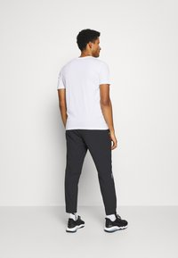 Puma - LOGO TEE - Print T-shirt - white - 2