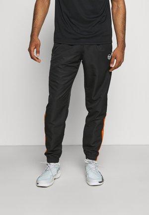 ABITA PANTS - Trainingsbroek - black/orange