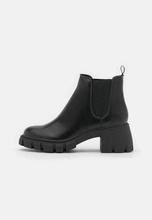 HOWLER - Platform ankle boots - black