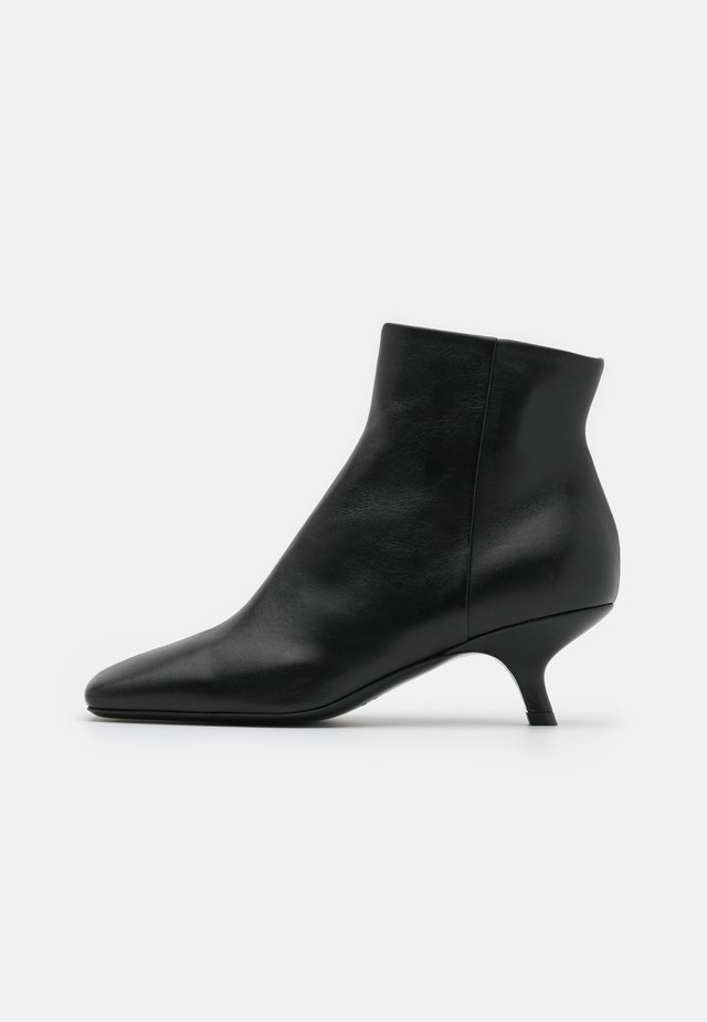 HOLLY - Bottines - nero