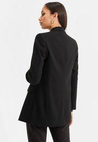 WE Fashion - Short coat - black - 2