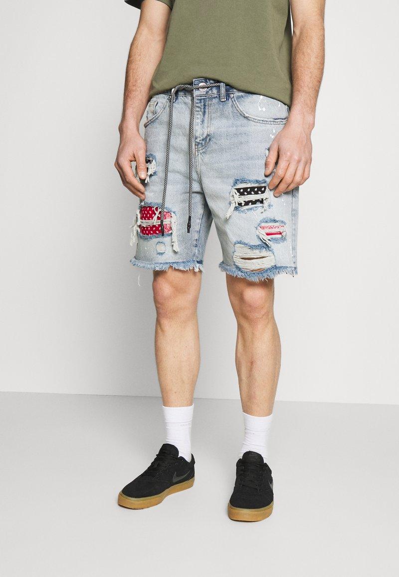 The Couture Club - BANDANA PATCH AND PAINT SPLAT CUT OFFS - Denim shorts - vintage blue