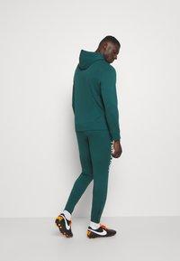 Nike Performance - FC  - Tracksuit bottoms - dark atomic teal/white/healing jade - 2