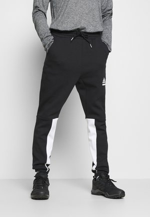 SPORTSWEAR PRIMEGREEN PANTS - Tracksuit bottoms - black/white