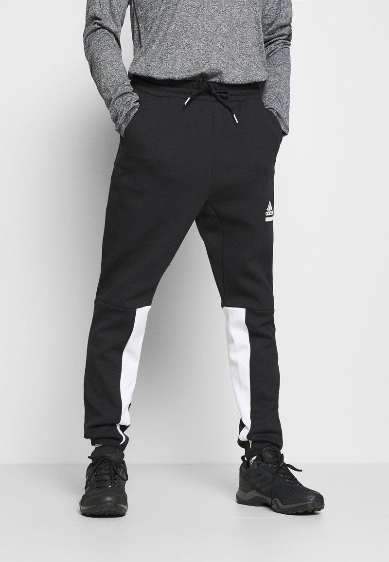 adidas Performance - SPORTSWEAR PRIMEGREEN PANTS - Träningsbyxor - black/white