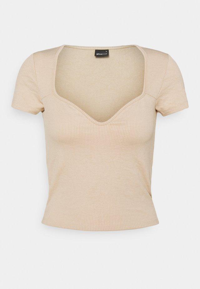 MARGOT BUSTIER - T-shirt med print - smoke gray