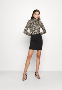 Pieces - PCNALA TURTLE NECK - Long sleeved top - natural - 1