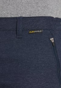 Jack Wolfskin - WINTER TRAVEL PANTS WOMEN - Pantalones montañeros largos - midnight blue
