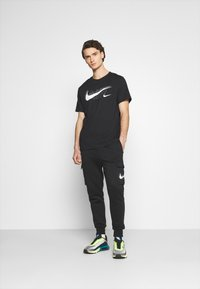 Nike Sportswear - TEE AIR - Triko spotiskem - black/reflective silver - 1