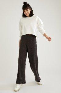 DeFacto - Trousers - black - 4