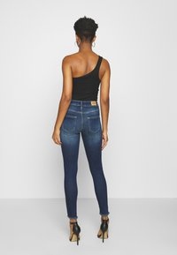 ONLY - ONLBLUSH LIFE - Vaqueros pitillo - dark blue denim