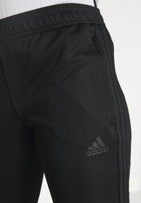 adidas Performance - TIRO - Tracksuit bottoms - black - 5