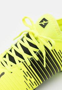 Puma - FUTURE Z 4.1 FG/AG JR UNISEX - Moulded stud football boots - yellow alert/black/white - 5