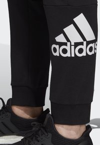 adidas Performance - MUST HAVES SPORT TAPERED SWEAT PANT - Verryttelyhousut - black - 3