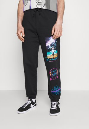 SIGNS - Tracksuit bottoms - black