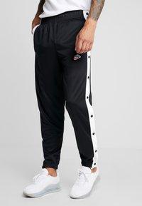 Nike Sportswear - TEARAWAY  - Tracksuit bottoms - black/white - 0
