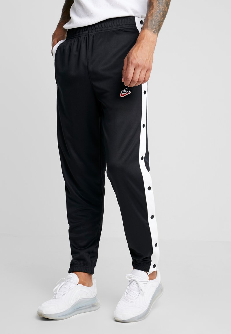 Nike Sportswear - TEARAWAY  - Tracksuit bottoms - black/white
