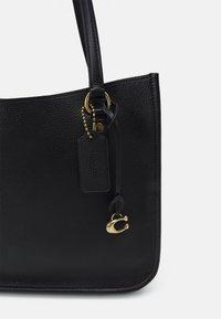 Coach - POLISHED TYLER CARRYALL - Weekend bag - black - 5