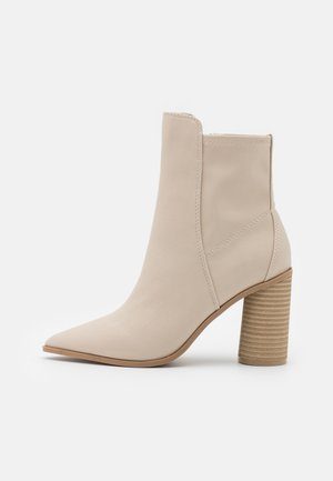 CLOEY - Classic ankle boots - bone