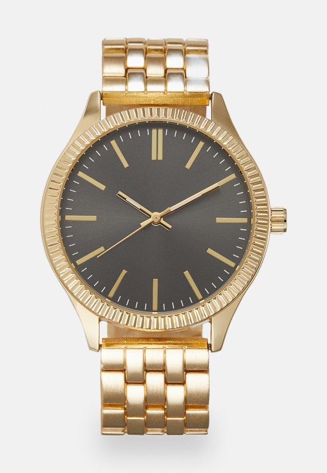 Reloj - gold-coloured